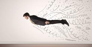 Biznesowego mężczyzna latanie z ręką rysującą wykłada nadchodzącego out Zdjęcia Stock
