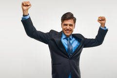 Biznesowego mężczyzna odświętności sukces przeciw Białemu tłu Obrazy Royalty Free