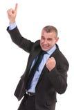 Biznesowego mężczyzna otuchy podczas gdy wskazywać oddolny zdjęcia stock