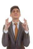 Biznesowego mężczyzna palce krzyżujący oczy zamykający Obrazy Royalty Free