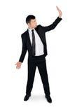 Biznesowego mężczyzna pchnięcie coś Zdjęcia Royalty Free