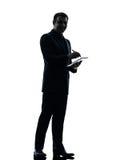 Biznesowego mężczyzna pióra stylus cyfrowa pastylka  sylwetka Obrazy Royalty Free