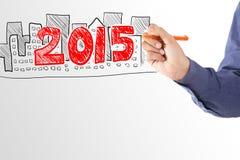 Biznesowego mężczyzna rysunku dom własność w roku 2015 Zdjęcie Stock