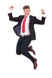 Biznesowego mężczyzna skakać ekstatyczny zdjęcia stock