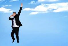 Biznesowego mężczyzna szczęśliwy skok obrazy royalty free