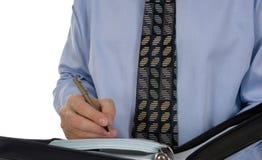 Biznesowego mężczyzna writing w rzemiennym organizatorze fotografia royalty free