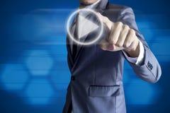 Biznesowego mężczyzna dotyka sztuki ikona na błękitnym tle Obrazy Stock