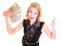 Biznesowej kobiety chwyty polerują pieniądze daje kciukowi up Obrazy Stock