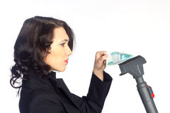 Biznesowej kobiety ciągnienia pieniądze od próżniowego cleaner zdjęcia royalty free