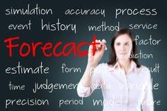 Biznesowej kobiety writing prognozy pojęcie niebieska tła Obraz Royalty Free