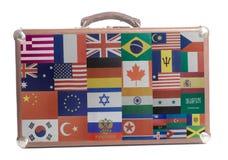 Biznesowej podróży walizka z flaga wszystkie kraje świat fotografia stock