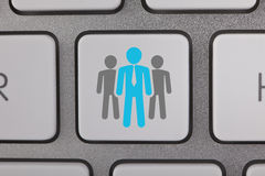 Biznesowi Błękitni ludzie na Komputerowej klawiaturze Fotografia Stock