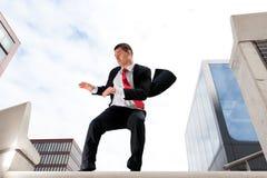 biznesowi doskakiwania mężczyzna potomstwa Fotografia Stock