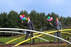Biznesowi mężczyzna z balonami Zdjęcia Royalty Free