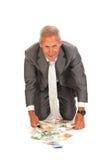Biznesowi mężczyzna znalezienia euro Fotografia Royalty Free