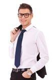 biznesowy żakieta mienia mężczyzna nad ramionami Fotografia Stock