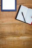 Biznesowy biurko z pastylką i notatnikiem Obrazy Stock