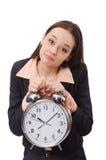 Biznesowy damy mienia budzik odizolowywający na Fotografia Stock