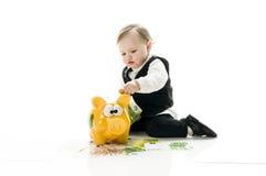 Biznesowy dziecko z piggybank Zdjęcie Royalty Free