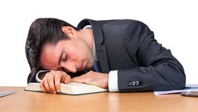 Biznesowy mężczyzna śpi nad książką Obraz Stock