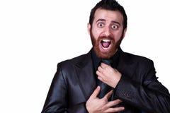 Biznesowy mężczyzna chwyta jego krawata krzyczeć fotografia stock