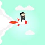 Biznesowy mężczyzna dostają rakietę jest przymocowywa sukces Obrazy Royalty Free
