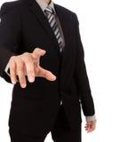 Biznesowy mężczyzna dotyka imaginacyjnego ekran przeciw Obrazy Royalty Free