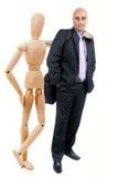Biznesowy mężczyzna i przegubna lala Obrazy Royalty Free