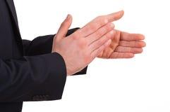 Biznesmen klascze jego ręki. Zdjęcia Stock