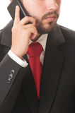 Biznesowy mężczyzna opowiada na smartphone Fotografia Royalty Free
