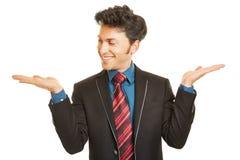 Biznesowy mężczyzna patrzeje puste ręki Zdjęcia Stock