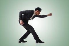 Biznesowy mężczyzna pozuje zażartą rywalizację Zdjęcia Stock