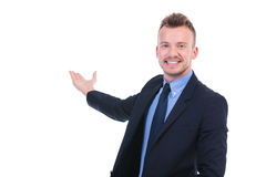 Biznesowy mężczyzna przedstawia coś Zdjęcia Royalty Free
