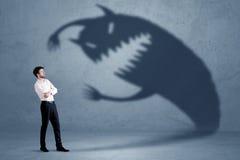 Biznesowy mężczyzna przestraszony jego swój cienia potwora pojęcie Obraz Royalty Free