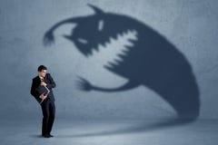 Biznesowy mężczyzna przestraszony jego swój cienia potwora pojęcie Obrazy Stock