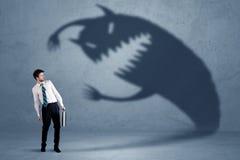 Biznesowy mężczyzna przestraszony jego swój cienia potwora pojęcie Obraz Stock