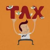 Biznesowy mężczyzna przyczepiał puszek ciężkim podatku słowem Fotografia Royalty Free