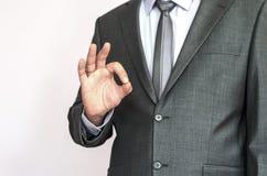 Biznesowy mężczyzna robi okey znakowi fotografia royalty free