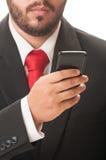 Biznesowy mężczyzna sprawdza jego smartphone Zdjęcie Stock