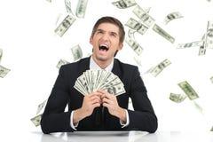 Biznesowy mężczyzna trzyma dolarowych rachunki i wrzeszczeć Fotografia Royalty Free
