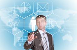 Biznesowy mężczyzna wskazuje jej palec przy obłocznymi ikonami Obrazy Stock