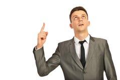 Biznesowy mężczyzna wskazuje up Zdjęcia Stock