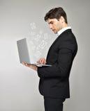 Biznesowy mężczyzna z laptopu i poczta ikoną Obraz Royalty Free