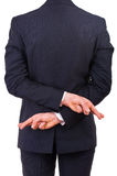 Biznesowy mężczyzna z palcami krzyżującymi. Obraz Royalty Free