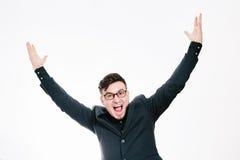 Biznesowy mężczyzna z rękami podnosić w sukcesie odizolowywającym na białym tle Obrazy Stock