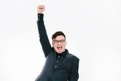 Biznesowy mężczyzna z rękami podnosić w sukcesie odizolowywającym na białym tle Obraz Stock