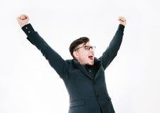 Biznesowy mężczyzna z rękami podnosić w sukcesie odizolowywającym na białym tle Obrazy Royalty Free