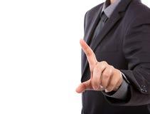 Biznesowy mężczyzna dotyka imaginacyjnego ekran przeciw Zdjęcia Royalty Free