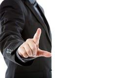 Biznesowy mężczyzna dotyka imaginacyjnego ekran przeciw Fotografia Stock