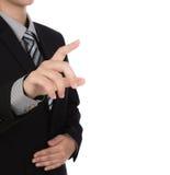Biznesowy mężczyzna dotyka imaginacyjnego ekran przeciw Zdjęcie Stock